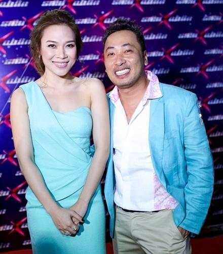 Mỹ Tâm và đạo diễn Nguyễn Quang Dũng mặc đồ cùng tông