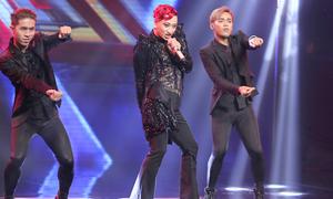 Chàng trai lưỡng tính nhảy trên giày cao gót ở X-Factor