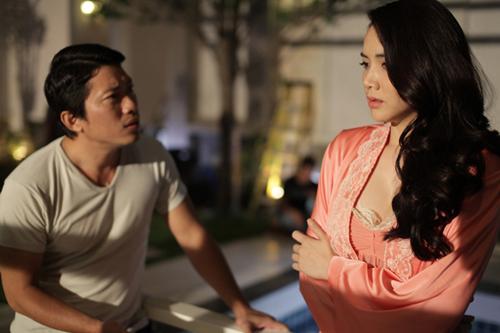 Kinh Quốc (trái) diễn xuất cùng Trang Nhung trong phim Scandal: