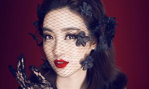 Hoa hậu Mỹ Linh khoe hình thể với đầm xuyên thấu