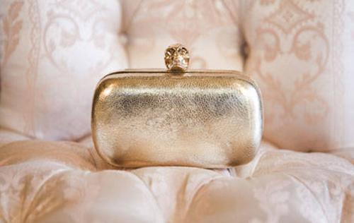 Alexander McQueen gold python box clutch, $2,595