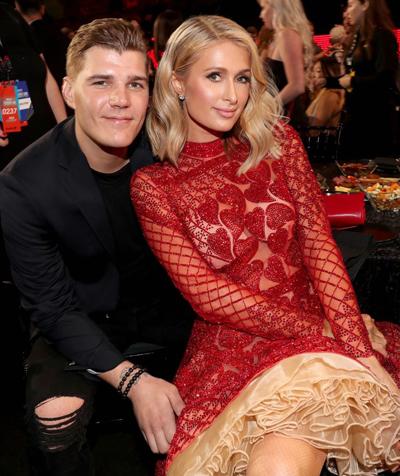 Paris Hilton và Chris Zylka tại sự kiện ngày 11/3.