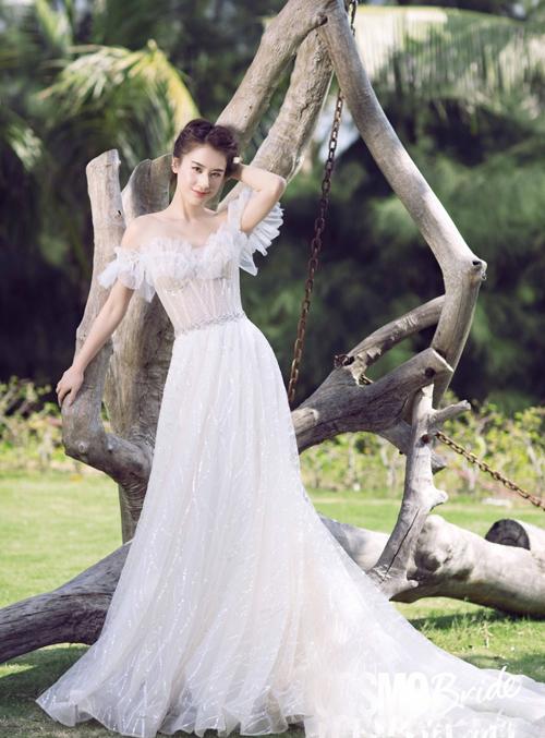 Huỳnh Thánh Y mặc váy cưới sau 10 năm mang tiếng giật chồng