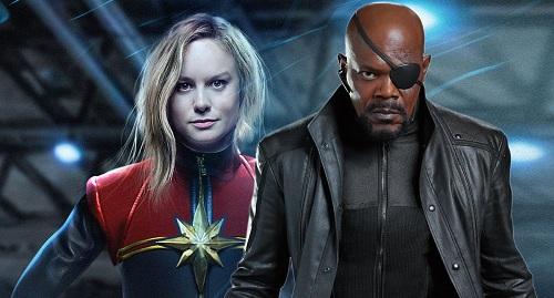Nick Furry (phải) cũng xuất hiện trong phim Captain Marvel. Tác phẩm này lấy bối cảnh thập niên 1990, diễn ra trước nhiều sự kiện hiện tại.