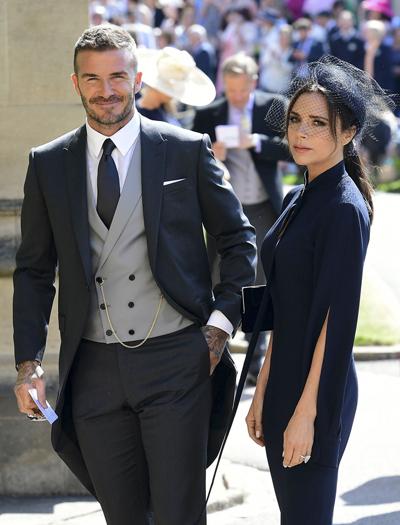 Vợ chồng Victoria Beckham dự đám cưới Hoàng gia hồi tháng 5. Ảnh: AFP.