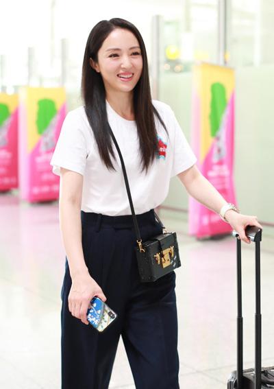 Đổng Tuyền tại sân bay ở Bắc Kinh, Trung Quốc hôm 12/9.