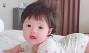 Hoa hậu Thu Thảo lần đầu chia sẻ ảnh con gái