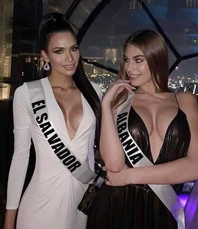 Váy xẻ sâu hở ngực được hai đại diện El Salvador và Albania lựa chọn.