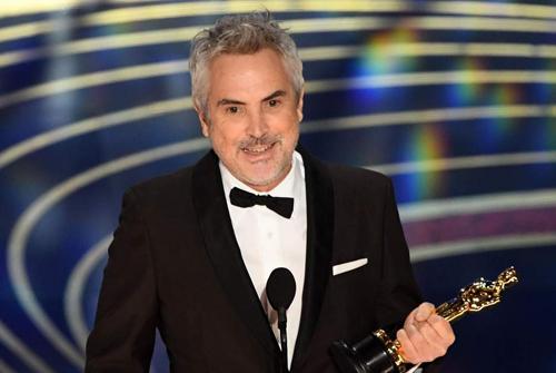 Alfonso Cuaron nhận ba giải Oscar, cho hạng mục phim nói tiếng nước ngoài, quay phim và đạo diễn. Ảnh: AFP.