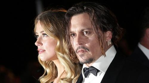 Vợ chồng Johnny - Amber xảy ra mâu thuẫn chỉ một tháng sau khi kết hôn năm 2015. Ảnh: Variety.