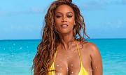 Siêu mẫu Tyra Banks khoe hình thể trên tạp chí đồ bơi