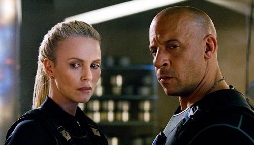Charlize Theron (trái) và Vin Diesel trên phim trường. Ảnh: Universal.