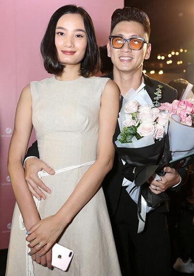 Vợ chồng Lê Thúy - Đỗ An dự công chiếu Siêu quậy có bầu, tối 18/9 tại TP HCM. Ảnh: Kiều Anh Kiệt.