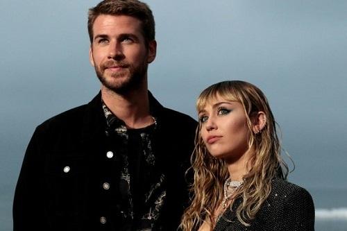 Miley và chồng cũ - Liam Hemsworth. Ảnh: AFP.