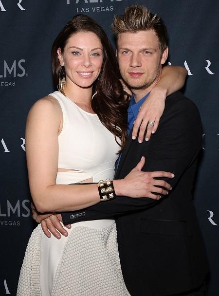 Nick Carter (phải) và vợ. Ảnh: FilmMagic.