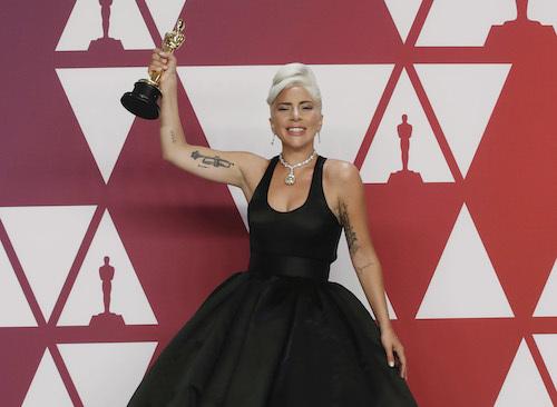 Lady Gaga nhận tượng vàng Oscar đầu tiên hồi đầu năm. Ảnh: Reuters.