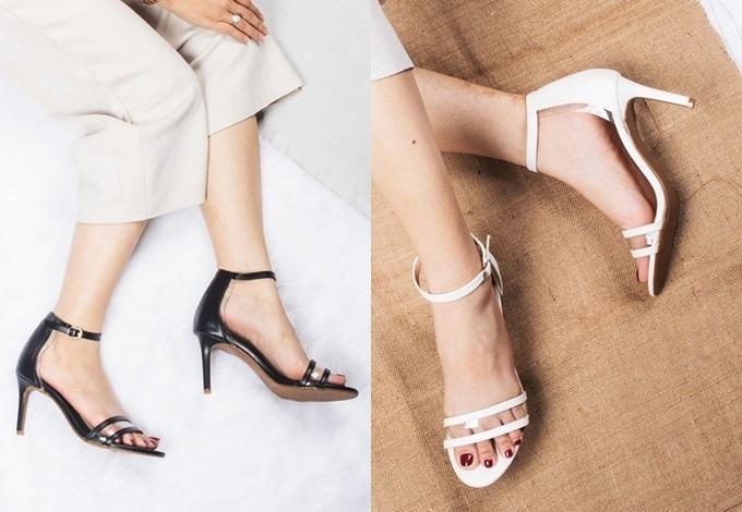 Giày sandal gót nhọnErosska EM017cao năm cm, có thiết kế cơ bản với quai đeo ngang, hở mũi và dáng tròn. Nhà thiết kế dùng chất liệu da mềm phủ bóng nhằm giúp phái nữ êm chân khi di chuyển. Lớp PU vuông cứng bao bọc gót giày để tạo sự cân bằng. Đế chống trượt giúp tăng cường độ bám. Sản phẩm đang giảm đến 50% trên Shop VnExpress, còn 149.000 đồng (giá gốc 298.000 đồng). Có nhiều tông màu cho chị em lựa chọn như trắng, đen, vàng bò và màu nude.