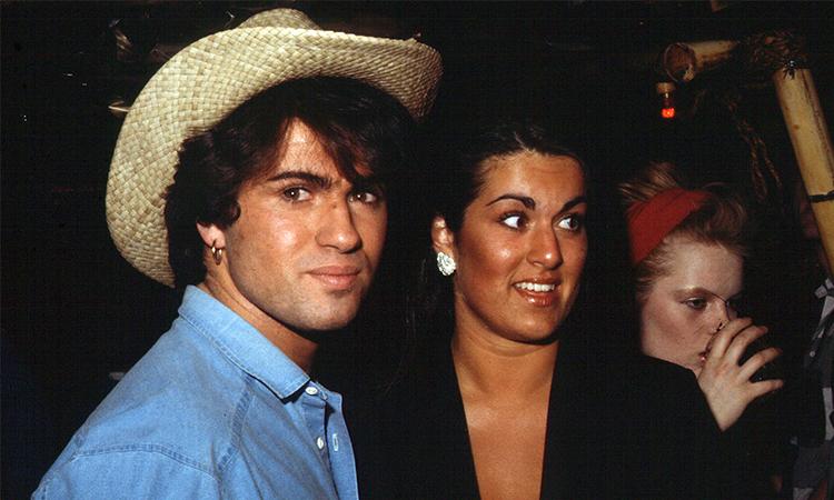 George Michael và em gái Melanie Panayiotou (áo đen). Ảnh: Zuma.