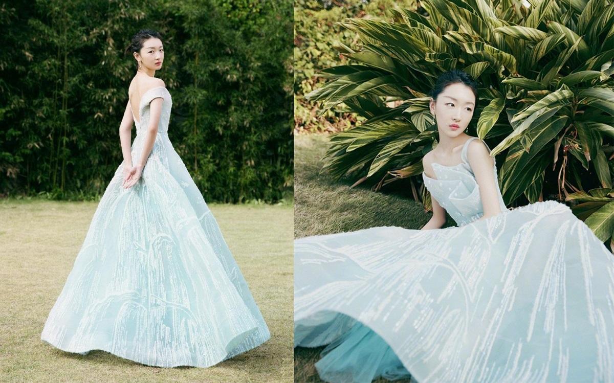 Châu Đông Vũchọn thiết kế bất đối xứng, màu xanh dương pha trắng của Azzi & Osta khi biểu diễn ca khúc Tuế Nguyệt trong lễ bế mạc Kim Kê 2019.