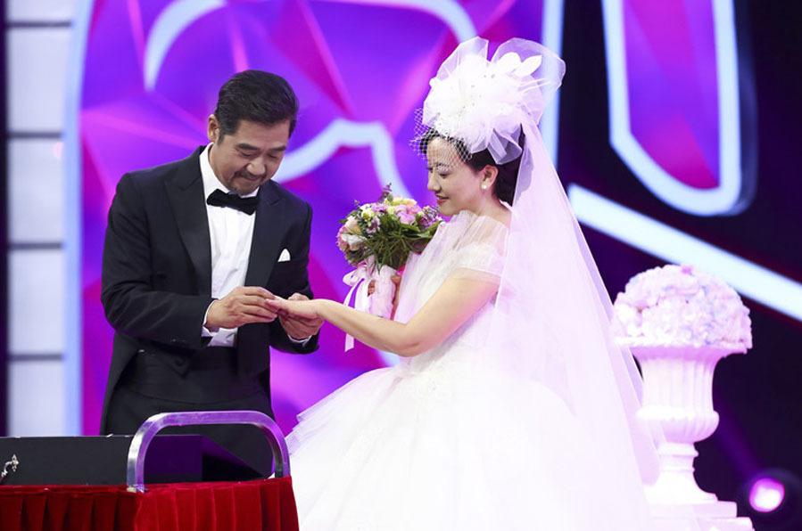 Vợ chồng tổ chức hôn lễ muộn năm 2018. Ảnh: Sina.