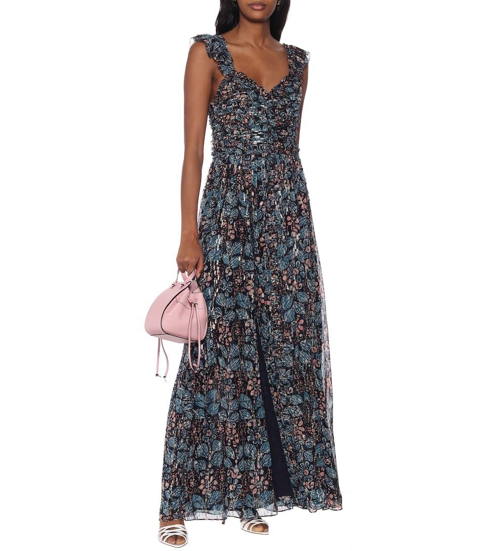 Maxi lụa của Ulla Johnson có tính ứng dụng cao, thích hợp dự tiệc cưới ở bãi biển hoặc tham gia các sự kiện ngoài trời, trong thời tiết ấm áp. Thiết kếin hoa màu xanh đen, phần dây và thân váy phối thun, tạo độ nhún và phồng, giá 1.066 USD (gần 25 triệu)