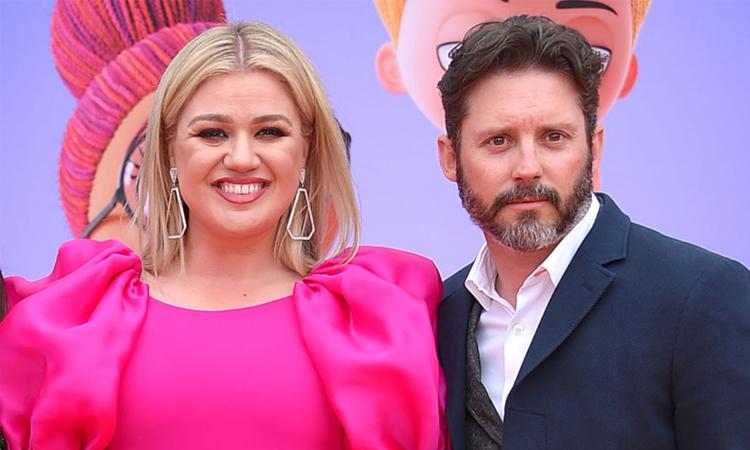 Kelly Clarkson và chồng dự công chiếu phim năm 2016. Ảnh: AFF-USA.