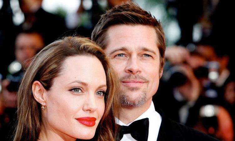 Angelina Jolie và Brad Pitt thời còn yêu. Ảnh: Reuters.