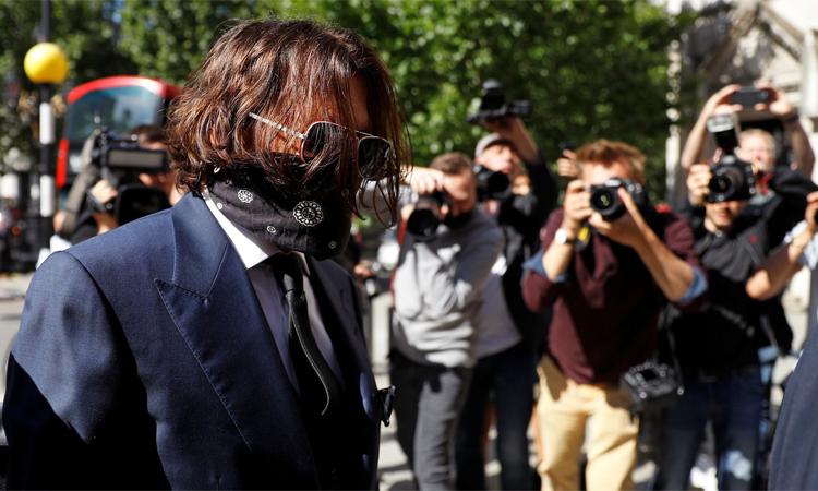 Johnny Depp có mặt tại tòa án Công lý Hoàng gia ở London hôm 7/7. Ảnh: PA.
