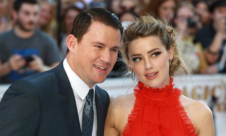 Channing Tatum (trái) đóng cùng Amber Heard phim Magic Mike XXL (2015). Ảnh: FilmMagic.