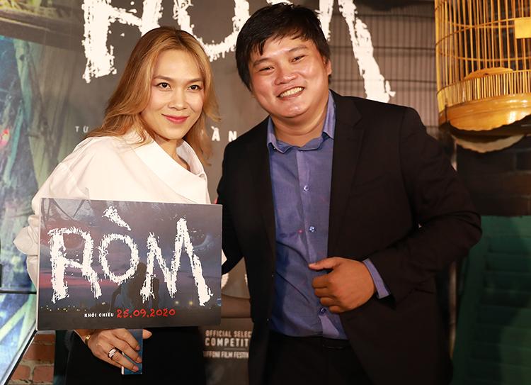 Đạo diễn Trần Thanh Huy bên ca sĩ Mỹ Tâm - khách mời tại sự kiện công chiếu phim Ròm tối 24/9. Ảnh: Hữu Khoa.