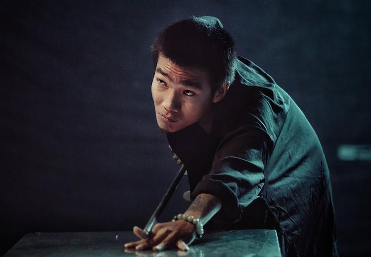 Rapper Wowy đóng vai phản diện chính - một đại ca giang hồ trong Ròm. Ảnh: Hồng Ngân.