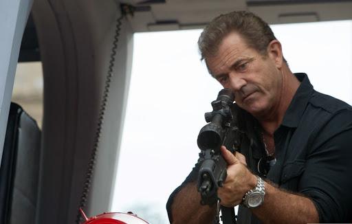 Năm 2014, ngôi sao hành động Sylvester Stallone mời Mel Gibson vào vai Conrad Stonebanks, trong The Expendables 3. Đây là thương hiệu phim hành động do Stallone viết kịch bản, gây chú ý do quy tụ các ngôi sao lớn của dòng phim hành động. Trong bài phỏng vấn của The State Journal, tháng 8/2014,  Stallone nhận xét Mel Gibson là một trong những ngôi sao hành động đáng nhớ nhất của Hollywood. Khi diễn cùng anh ta (Gibson), tôi thường quên lời. Tôi cảm thấy choáng ngợp trước thần thái của bạn diễn, Stallone chia sẻ. Anh: ManlyMovie.