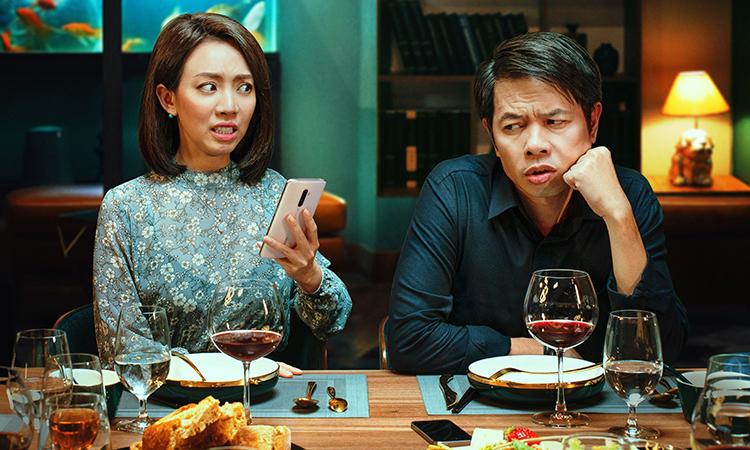Thu Trang - Thái Hòa đóng vai vợ chồng trong phim Tiệc trăng máu. Ảnh: Lotte.