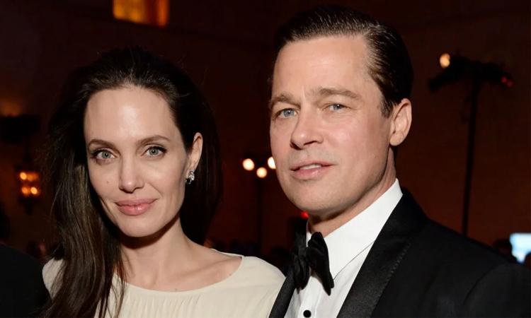 Angelina Jolie (trái) và Brad Pitt thời còn là vợ chồng. Ảnh: Instyle.