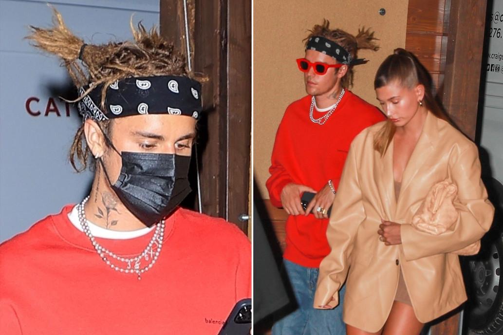 Justin Bieber để tóc tết bện thừng khi đi ăn tối với vợ - người mẫu Hailey Baldwin tối 3/5. Ảnh: Backgrid.