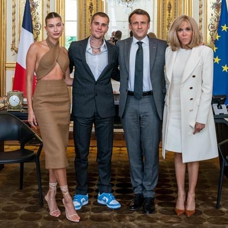 Vợ chồng cặp sao chụp ảnh cùng tổng thống Pháp và phu nhân.