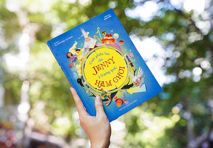 Bìa sách Cuộc phiêu lưu của Jenny ở Vương quốc Ham Chơi. Ảnh: NXB Kim Đồng.