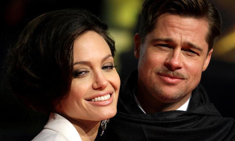 Brad Pitt (phải) và Angelina Jolie thời còn là vợ chồng. Ảnh: Reuters