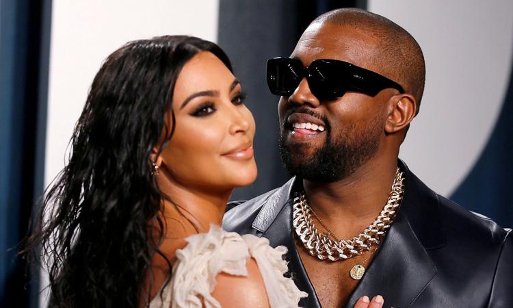 Kim Kardashian (trái) và Kanye West. Ảnh: AFP